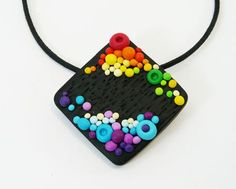 sue - nice contrast of colors with the black textured background - perles pois 05 Plus Polymer Clay Necklace, Polymer Clay Pendant, Fimo Clay, Polymer Clay Projects, Polymer Clay Creations, Polymer Clay Art, Jewelry Crafts, Handmade Jewelry, Clay Design