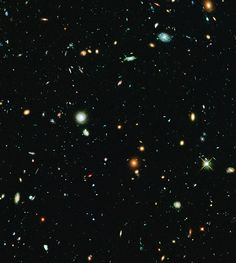 This long-exposure Hubble Space Telescope image of massive galaxy cluster Abell 2744 is the deepest ever made of any cluster of galaxies. It shows some of the faintest and youngest galaxies ever detected in space. Abell 2744, located in the constellation Sculptor, appears in the foreground of this image. It contains several hundred galaxies as they looked 3.5 billion years ago. The immense gravity in Abell 2744 acts as a gravitational lens to warp space and brighten and magnify images of…