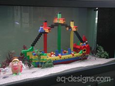 225 gallon aquarium.  We built a large ship out of Legos for the decoration.  We took it out after a couple of years because it was too hard to keep clean.