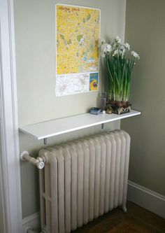 Look!: Radiator Shelf radiator shelf - make use of the wasted space over a radiator The space betwee Radiator Shelf, Radiator Heater, Radiator Cover, Radiator Ideas, Wall Radiators, Nursery Shelves, Apartment Living, Apartment Therapy, 1st Apartment