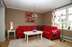 Perhaps good wall color with the red sofa