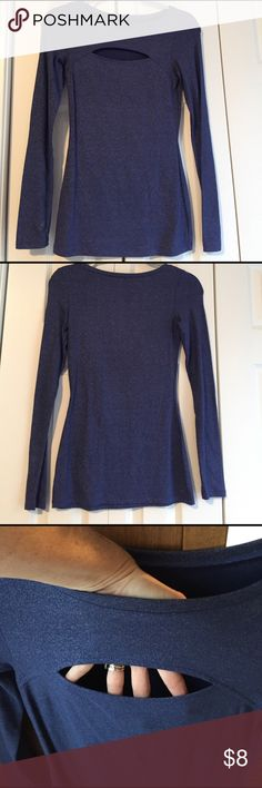 Express top size CA Fun and shimmery blue peek-a-boo knit top from Express.  Form fitting and very sexy.  Made from 57% cotton, 38% modal and 5% spandex.  Hardly worn and in perfect condition Express Tops