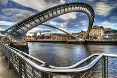 The Millennium Footbridge across the River Tyne in Newcastle. Designed by Wilkinson Eyre Architects and engineered by Gifford, This award winning structure takes its place at the end of a line of distinguished bridges across the River Tyne