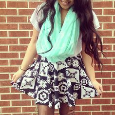 Neon infinity scarf paired with tights, abstract patterned loose fitting skirt and tee