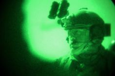 As seen through a night-vision device, a U.S. Special Forces soldier prepares to move toward Dewai Kalay village in the Maiwand district in Afghanistan's Kandahar province, Jan. 14, 2014. The U.S. soldier is assigned to Special Forces Operational Detachment Alpha. The unit assisted Afghan commandos with a clearing operation to disrupt insurgents from using Dewai Kalay village and surrounding areas as a safe haven. U.S. Army photo by Staff Sgt. Bertha A. Flores