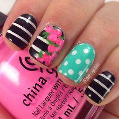 Bright striped floral mix and match manicure #nailart #manicure #nails #naildesign #manicureideas #polkadotnails #floralnails #stripednails