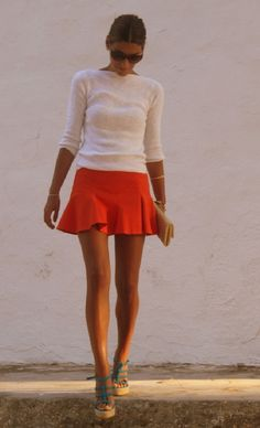 White shirt, little red skirt and sandals