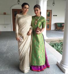 KAREENA KAPOOR KHAN AND KARISMA KAPOOR They're the first ladies of Bollywood and boy do they dress the part. Both Kapoor's recently opted for Indian outfits—Karisma looking elegant in a cream Sabyasachi sari while Kareena had some fun with colour by Pakistani Dresses, Indian Dresses, Indian Outfits, Indian Attire, Indian Wear, India Fashion, Asian Fashion, Indian Fashion Trends, Moda India