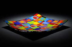 fused glass, dish, black base with opaque squares. case island glass site