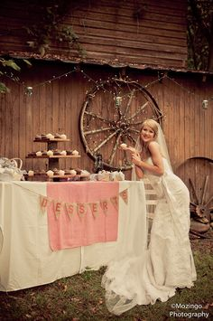 Cupcake table  #log #rustic #wedding #burlap #bunting #gingham #tiered #stand #wagonwheel