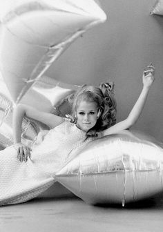 Lauren Hutton reclines on an Andy Warhol silver helium-filled pillow. Photo: Gianni Penati, 1966.