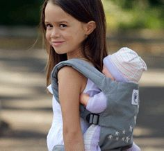 having my oldest carry her doll with us  #ergobaby #idealmothersday #babywearing