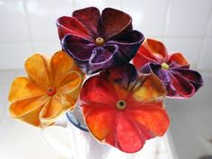 Filth Wizardry: Kitchen paper and baby wipe Kanzashi flowers.