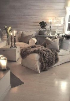 Sumptuous lounge using tupe and white combined with layers of texture to create this cosy yet stylish look