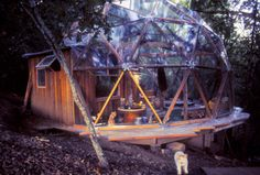 Geodesic Dome:  I lived in one of these as a small child and loved it.  It wasn't all glass, though.