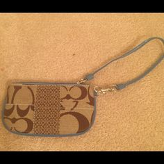 Coach wristlet Brown and blue coach wristlet with silver accents Coach Bags Wallets