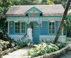 A Chattel House Cottage by the Sea - The late Lord Glenconner (Colin Tennant) standing in front of one of his cottages on St. Lucia