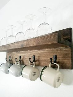 Floating Shelf   Mug holder Made to order and carefully constructed by hand adding a farmhouse charm to any home. This shelf is practical for home organization Looks great in kitchens for storing mugs, wine glasses, spices and pots. Also for use as a coat rack or mail and key