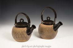 Two awesome teapots by artist Bill Giese