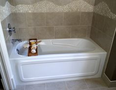 While small bathrooms certainly make it difficult, there are special soaker tubs on the market designed for smaller bathrooms. What they lose in depth or width, they make up in both comfort and price.  To accommodate your small bathroom, the following eight small tubs are five feet long (or less) and cost less than $1,000. While the average price to install a bathtub is $2,300, these specialty-designed soaker tubs will surely cost less, even if you hire a professional.