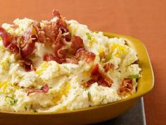 Bacon-Cheddar Mashed Potatoes (No. 12) : Cook 1/2 pound chopped bacon until crisp. Cover 2 pounds whole russet or Yukon gold potatoes with cold salted water