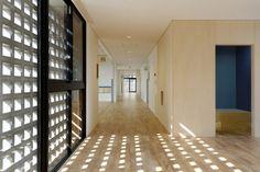 Hanazono Kindergarten designed by HIBINOSEKKEI + youji no shiro in Japan | the grid concrete façade promotes interesting shadows