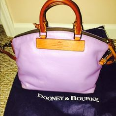 DOONEY AND BOURKE PURSE! Has been used! The bottom has one big scratch on it and the bottom corners are a little scratched. The inside a small stain in it! Dooney & Bourke Bags