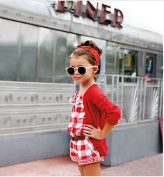 I love rompers on little girls.  and with a belt!  Just add L's gold belt to her orange polka dot romper