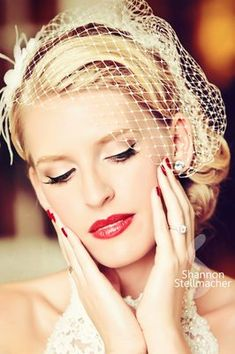 Vintage brides are very in right now! The nude eye lid, with the crisp black liner and a bold red lip is one of our most popular looks right now :)