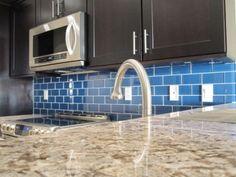 We used an ocean blue glass subway tile for the backsplash
