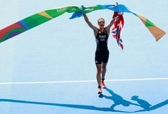 Alistair Brownlee of Great Britain celebrates after crossing the finish line…