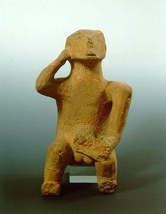 Neolithic figurine. Clay idol representing an ithyphallic seated man, found in Thessaly. The unique in its kind rendering of the male figure, possibly a god, is an outstanding example of the Chalcolithic sculpture. Dated to 4500-3200 B.C. Inv. no. 5894.