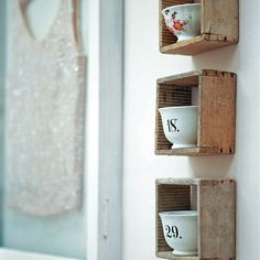 old wooden boxes turned into individual shelves