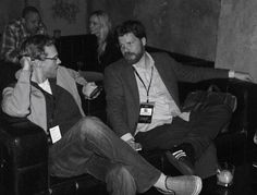 AFI FEST Associate Programming Director Lane Kneedler (R) takes a few minutes to relax and chat with a co-worker at the HOLY MOTORS party.