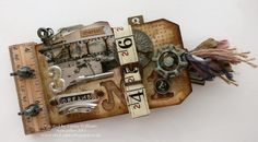Tag Book ~ Tim Holtz -too cute. looks like it would be easy and fun to make.-