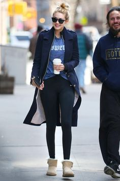 Gigi Hadid wearing Ugg Mini Bailey Button Boots, House of Cb Anais Navy Wool Button-Through Coat, Ill.I Optics. Metal Detail Round Sunglasses, Nike Legend Tights and Gracedbygrit Movie Star Jacket