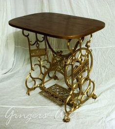 Old Sewing Machine Converted To A Table. Rounded Wood Table Top On Bronze  Metal Legs.