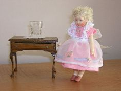 Another tiny. She is a Kishlet next to a dollhouse table I built. The vase is a thimble. Tiny Dolls, Thimble, Smocking, Harajuku, Vase, Clothes, Style, Fashion, Layette