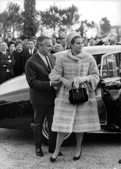 Princess Grace and Prince Rainier of Monaco (c. 1965)Check out the Monegasque coat of arms design on her handbag!