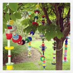 Plastic lids re-used as tree decoration - maybe a party idea for little ones?