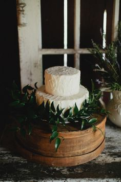 rustic white cake surrounded by greenery | Photography by kristynhogan.com, Design, Styling and Florals by http://www.cedarwoodweddings.com  Read more - http://www.stylemepretty.com/2013/09/06/french-farm-inspired-photo-shoot-from-kristyn-hogan-cedarwood-weddings/