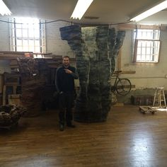 Base of wood model for Ona, a bronze piece installed at Barclays Center. Ursula VonRydingsvard's Studio Manager Sean Weeks Earp for scale.