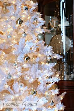 """every white, gold, silver, and cream ornament  with a vintage """"Shiny Brite"""" look. She started with a burlap ribbon that had a gold thread running through it and then some sheer gold ribbon to fill in.Common Ground: Treetopia's White Tree"""
