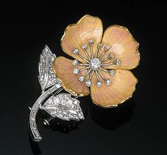 An Enamel and Diamond Flower Brooch by Boucheron The pink guilloch enamel petals with diamond-set detail to the baguette-cut diamond stem and pav-set leaves, with grey suede case by Boucheron, with French assay mark, 5.5 cm high Signed Boucheron, Paris, No. 14.738