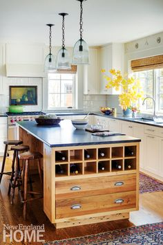 The clean-lined and practical kitchen was smartly designed by Pennoyer and his associate Jasmine Pinto. They used Jet Mist honed granite for the countertops and found the backsplash tile locally, at Cider Press Tile in Keene.