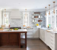 Crazy for Copper - Design Chic love the large marble subway tiles, the clean hardware, white cabinets, and touch of copper
