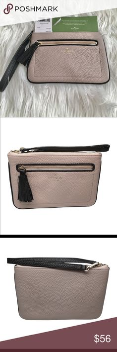 Kate Spade Wristlet Kate Spade New York pebbled leather wristlet handbag Gold toned hardware; Top zip closure Front pocket with tasseled zipper pull; Wristlet strap with drop of approx. 5.5 inches Interior features custom fabric lining and 4 card slots Approx. dimensions: 7.5 in (L) x 5 in (H) x 0.5 in (W) kate spade Bags Clutches & Wristlets