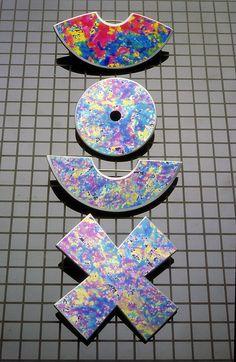 Jane Adam - Symbols.  Brooches in dyed anodised aluminium and acrylic  1985