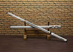 "Ninja Sword Katana/Folding pattern steel blade/Solid wood scabbard/Alloy fitted/Length 39"" Katana http://www.amazon.com/dp/B01DO6XJ1I/ref=cm_sw_r_pi_dp_oyt.wb18ZCDZK"