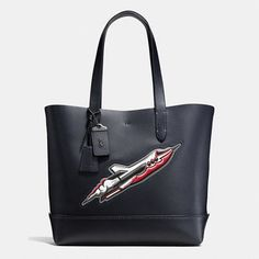 And if you are really in the mood to drop some serious coins, a sleek Coach rocket ship tote will take your style to infinity and beyond.